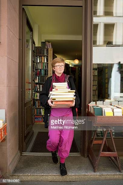 Student carrying stack of books