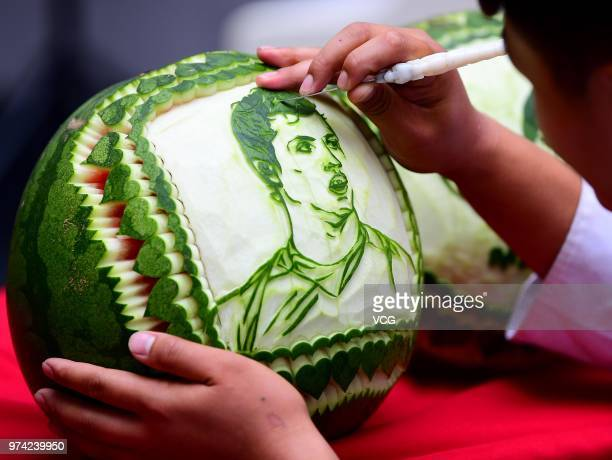 A student carves a portrait of Cristiano Ronaldo on a watermelon at Shenyang Foreign Affairs Service School ahead of the FIFA World Cup on June 14...