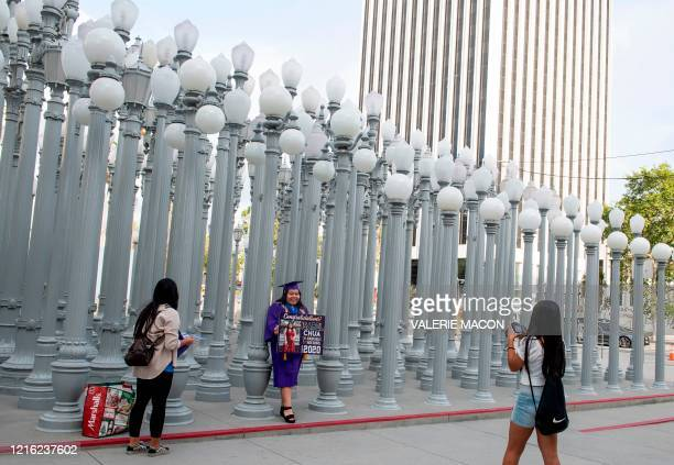 Student celebrates her graduation at LACMA Museum, amid the Covid 19 pandemic, May 29 in Los Angeles, California. - Governor Gavin Newsom announced...