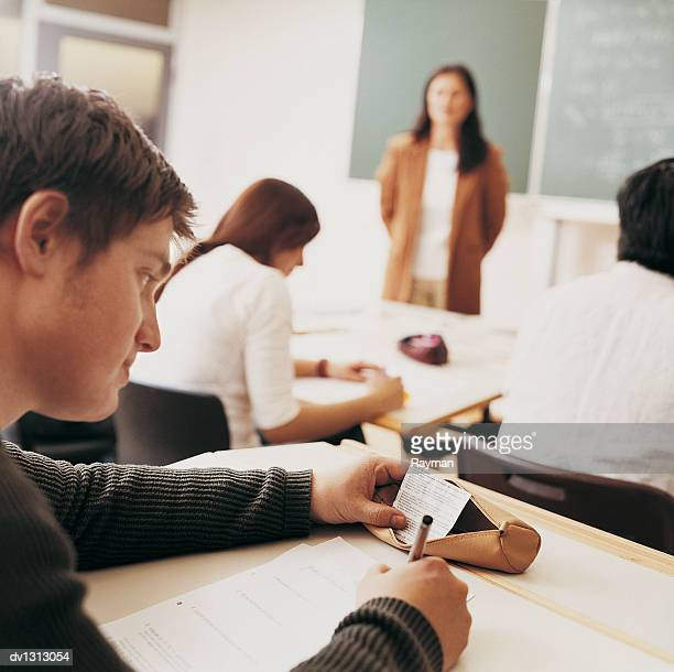Student Cheating in An Exam Watched By a Lecturer