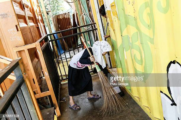 A student cleans the front of a classroom at MASTER school on February 20 2014 in Depok West Java Indonesia The school is known as Masjid Terminal...