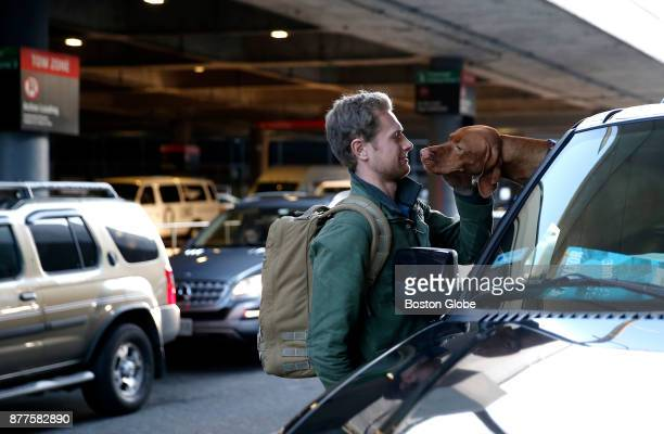 UVA student Colby LaPointe is greeted by his dog Henley at Logan Airport in Boston as he arrived to go home to Kennebunk ME for Thanksgiving on Nov...