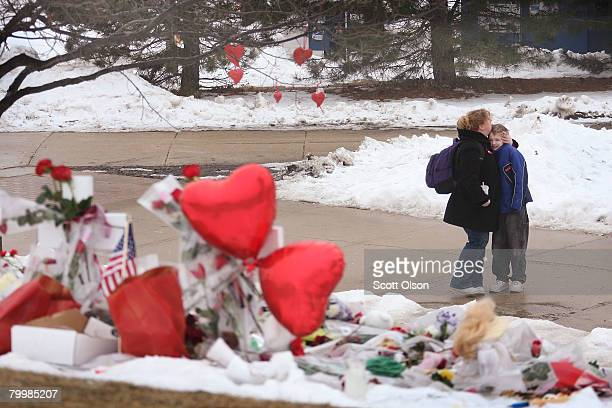 Student Colleen Burns embraces her son Ryan near a memorial to slain students on the campus of Northern Illinois University February 25 2008 in...