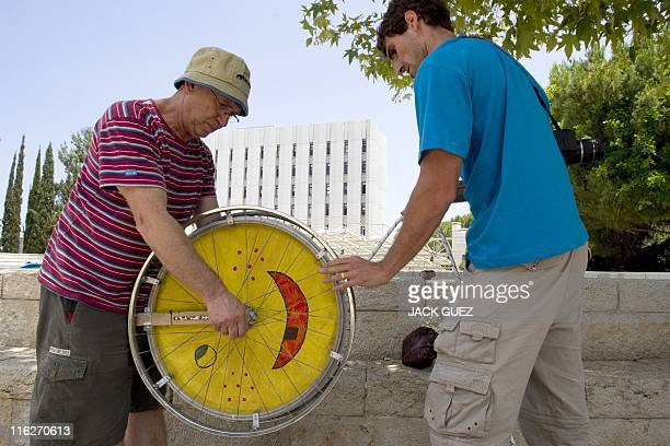 A student competitor and a relative prepare a yoyo before the start of the longest yoyo competition at the Technion Institute of Technology in Haifa...