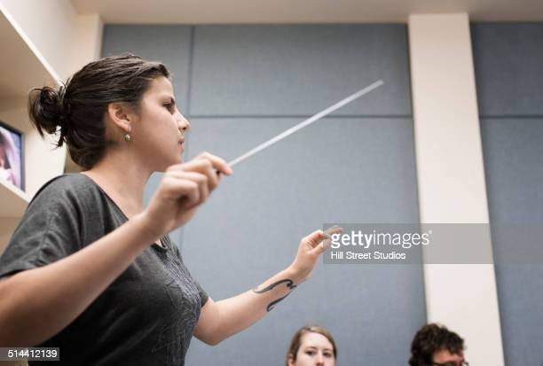 Student conducting in music class