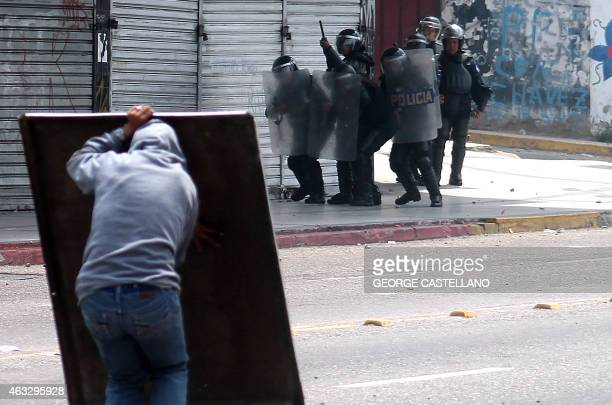 A student confronts riot police during an opposition protest in San Cristobal Venezuela on February 12 2015 Opposition students marched Thursday in...