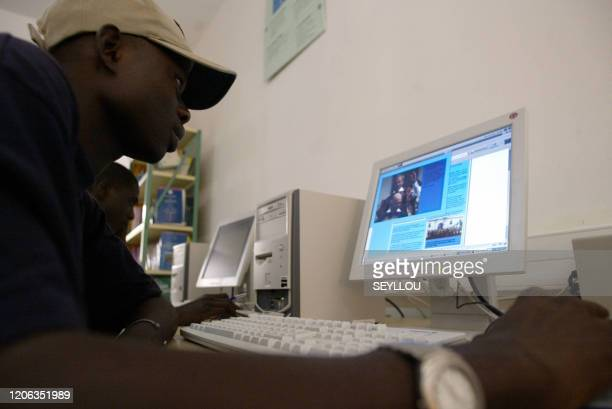A student consults his computer 22 November 2004 at the Dakar Francophone Digital Campus The CNFD is an educational facility established in 2000 by...