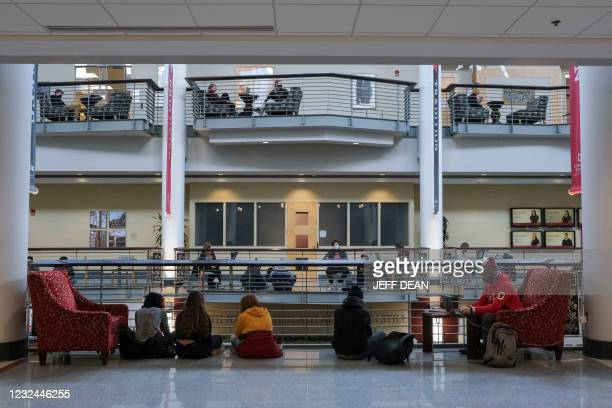 Student continues to study as Ohio State University students stage a sit-in at the Ohio Union building on the campus of The Ohio State University in...
