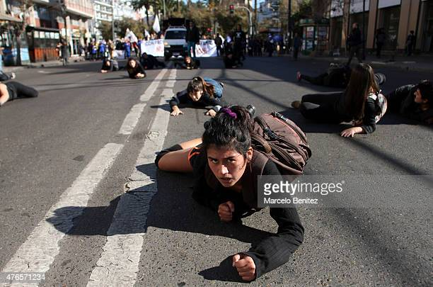 A student crowls on the street during a protest to demand more participation of students and teachers on the educational reform process on June 10...