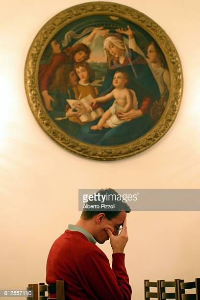 Student, Cyrille Debris pauses for reflection inside Rome's French Seminary chapel.