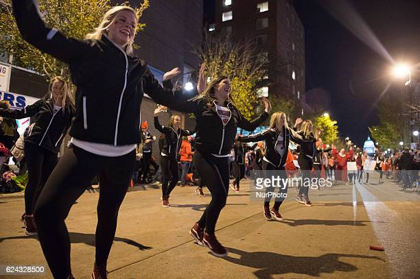 Student dancers from the University of WisconsinMadison performed on State Street in Madison WI during the school's annual Homecoming Parade on Nov...