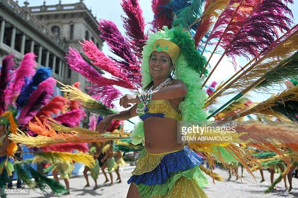 A student dances during a parade to commemorate the 187th anniversary of Guatemala's independence from Spain at Constitution Square in Guatemala City...