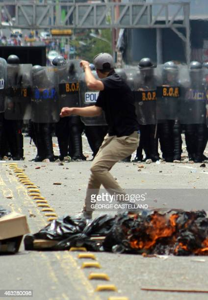 A student demonstrates in front of a line of riot policemen during a protest against Venezuelan President Nicolas Maduro's government in San...