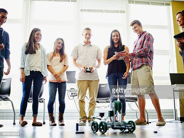 Student demonstrating robot during robotics class