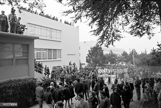 Student demonstrators march in front of the San Francisco State College administration building to protest the school's lack of a minority studies...