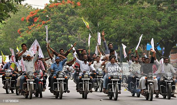 Student demonstrators participate in a bike rally in support of a hunger strike by Osmania University students Joint Action Committee for the...