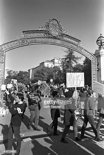 Student demonstrators walk in a picket line at the Sather Gate entrance to the University of California, Berkeley, California, early 1969. Student...