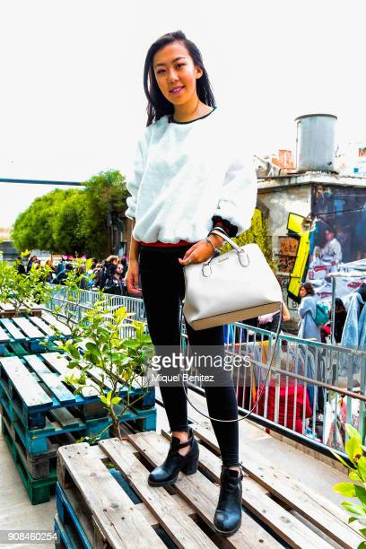 Student Diana Su is wearing a Top Chop pants Spring boots Kate Spade handbag Heron red cloth bag vintage market's sweater and Pandora jewelry during...