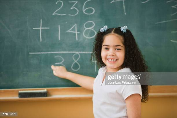 student doing mathematics on the chalkboard - dominican ethnicity stock photos and pictures