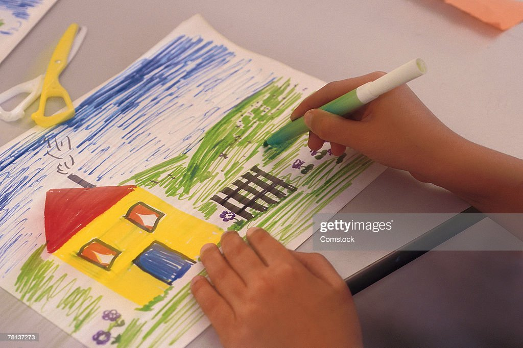 Student Drawing And Coloring With Markers High-Res Stock ...