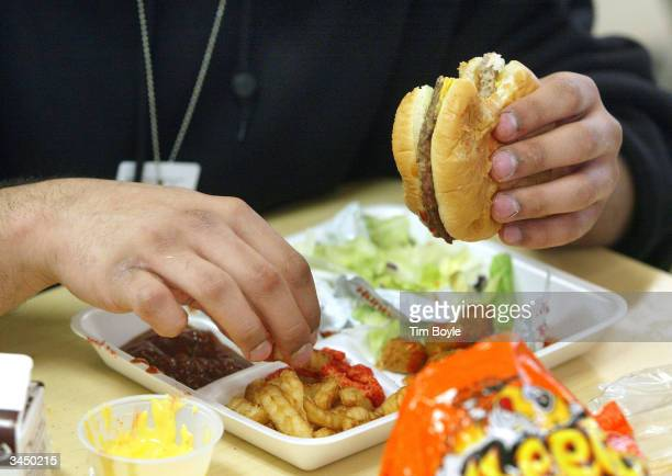 Student eats lunch at Jones College Prep High School April 20, 2004 in Chicago, Illinois. The Chicago Public School system will introduce next fall a...