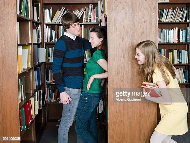 Student eavesdropping on classmates in library