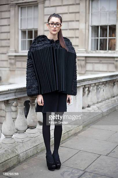 Student Emiley Brooks wearing office shoes and a Lulu Liu dress and cape at London Fashion week autumn/winter 2012 womenswear shows on February 17...