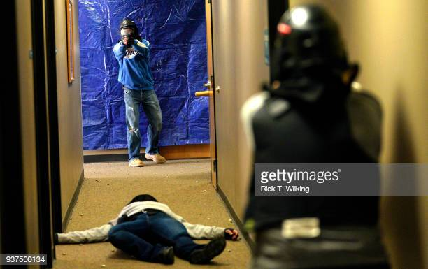 A student engages a gunman over a mock shooting victim during a Tac*One Consulting 'Lone Wolf' civilian active shooter response course for concealed...