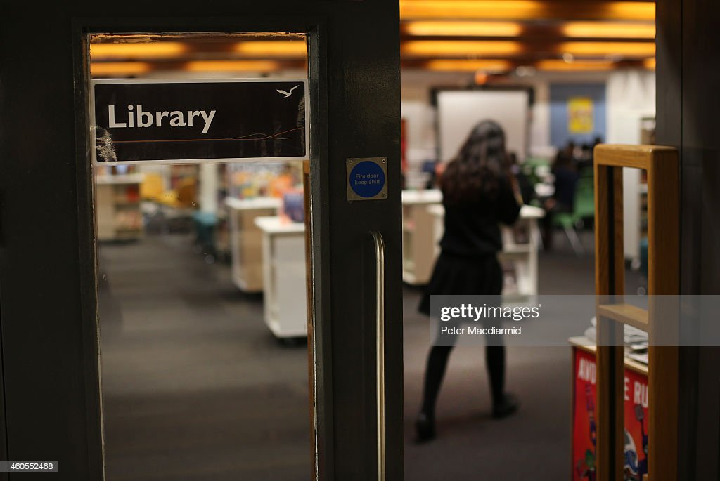 A student enters the library at a secondary school on December 1, 2014 in London, England. Education funding is expected to be an issue in the general election in 2015.