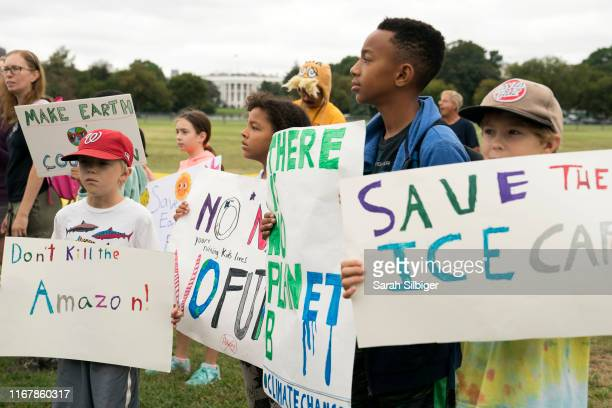 Student environmental advocates participate in a strike to demand action be taken on climate change outside the White House on September 13, 2019 in...