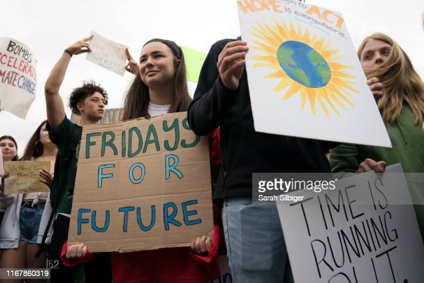 Student environmental advocates participate in a strike to demand action be taken on climate change outside the White House on September 13 2019 in...