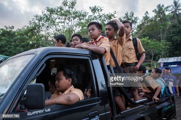 Student evacuated from their home due to the volcanic activities of Mount Agung on a car as they head of school in a temporary shelter in in...