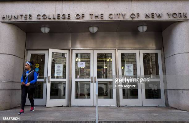 A student exits a building on the campus of Hunter College of The City University of New York April 10 2017 in New York City Following a state budget...