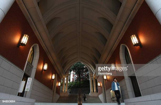 A student exits from Keio University in Tokyo Japan on Wednesday Nov 19 2008 Japan's top universities are falling victim to the global financial...