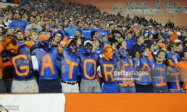 Student fans of the Florida Gators show team colors during play against the Vanderbilt Commodores on November 7 2009 at Ben Hill Griffin Stadium in...