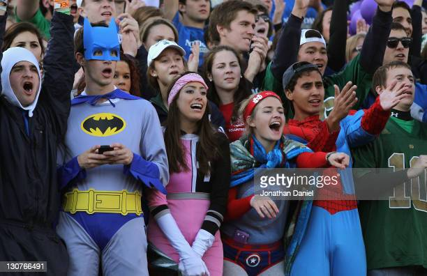 Student fans of the Notre Dame Fighting Irish dressed in costumes, cheer on their team against the Navy Midshipmen at Notre Dame Stadium on October...