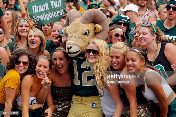 Student fans pose for a photo with Cam the mascot of the Colorado State Rams as they face the Colorado Buffaloes in the Rocky Mountain Showdown at...