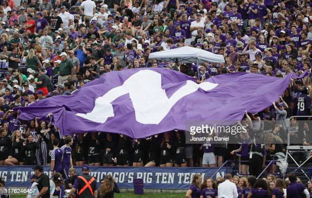 Student fans wave a Northwestern flag during a game between the Northwestern Wildcats and the Michigan State Spartans at Ryan Field on September 21,...