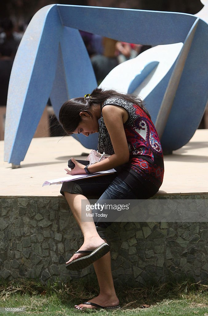 A student fills in the admission form at a Delhi University college at the North campus on June 1, 2010.