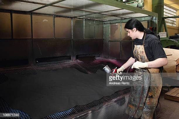 A student finishes a part of a leather at the LGR tannery school on November 16 2010 in Reutlingen Germany The LGR school established in 1954 is...