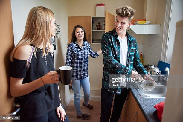 student flatmates in the kitchen