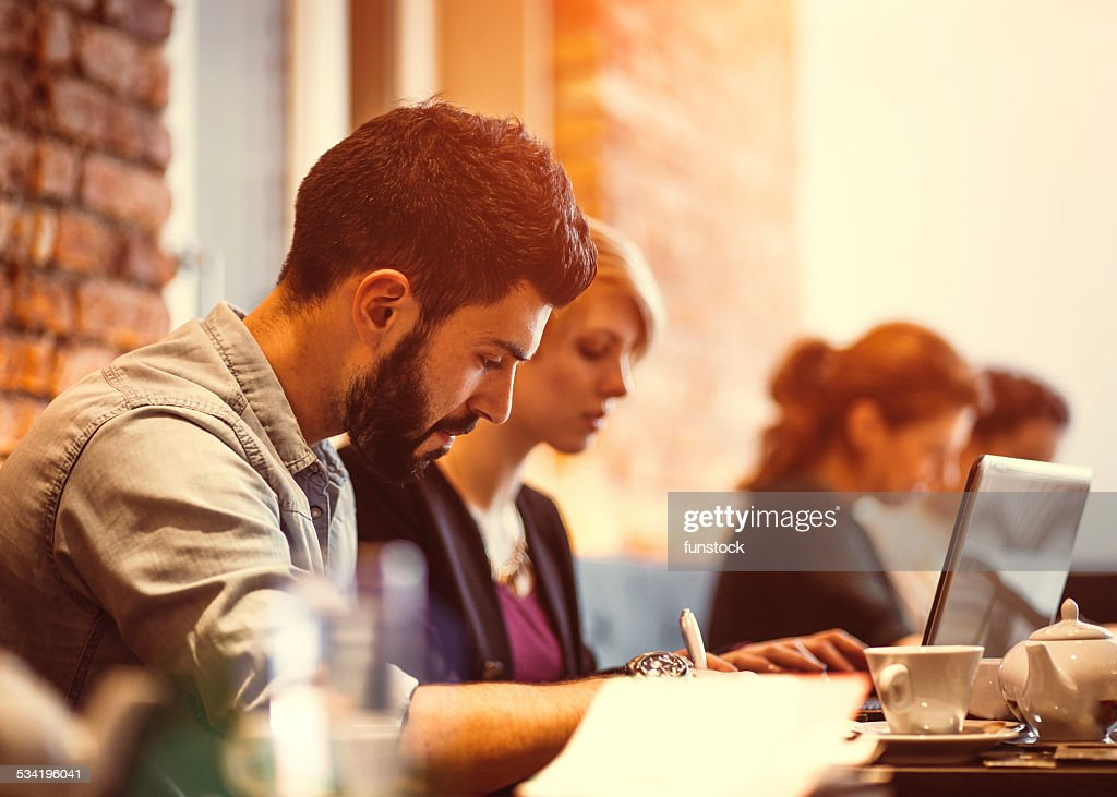 Student friends studying at cafe : Stock Photo