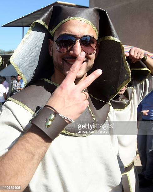A student from alRafidain private college wear a Pharaohs costume to celebrate his graduation as Baghdad universities hold graduation parties for...