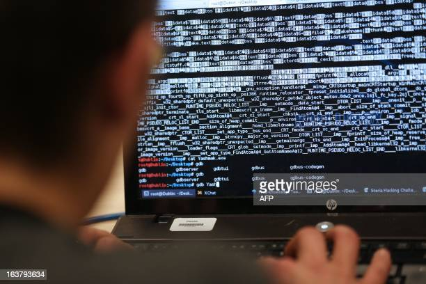 A student from an engineering school attends on Meudon west of Paris overnight on March 16 the first edition of the Steria Hacking Challenge AFP...