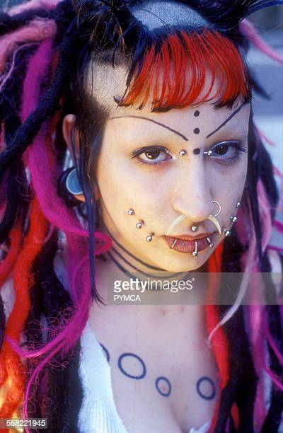 A student from FIT in NYC who is a Cyber Goth with piercings and coloured wool in her hair New York USA 2002