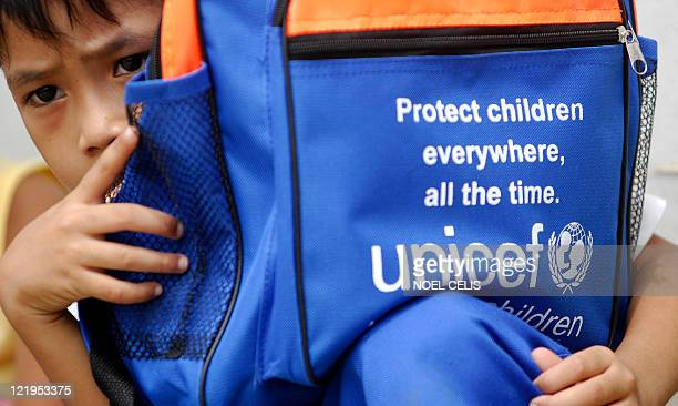 A student from Nangka Elementary School holds a bag donated by the United Nations Childrens Fund in Marikina east of Manila on October 23 2009 The...