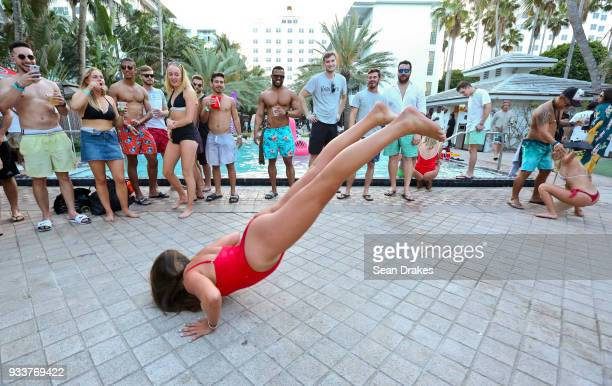 A student from Sweden performs the worm dance during the launch pool party produced by 935FM Revolution Radio Miami at the Nationl Hotel on South...