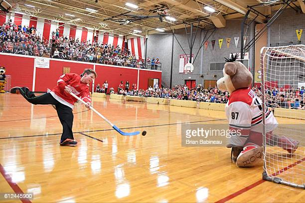A student from the Bothwell Middle School shoots on the Carolina Hurricanes mascot Stormy on October 4 2016 in Marquette Michigan