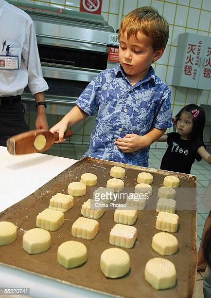 A student from the Chengdu American School learns to make Moon Cake at the Carrefour Supermarket on September 8 2005 in Chengdu of Sichuan Province...
