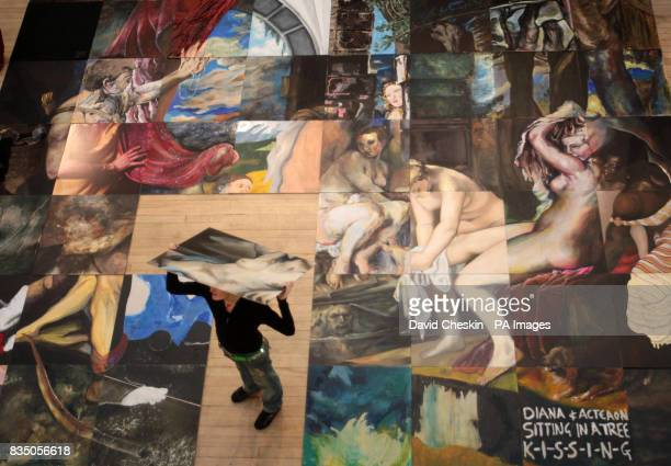 A student from the Edinburgh College of Art gather poses for photographs in Edinburgh around their large scale reproduction of Diana and Actaeon...